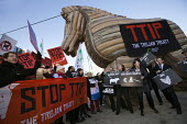 No TTIP campaigners lobby outside the European Commission with a Trojan Hourse. Brussels, Belgium. - Jess Hurd - 04-02-2015