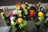 Road Traffic Accident training with White Watch at Paddington Fire Station. Releasing a trapped passenger from a car. London. - Jess Hurd - 17-03-2015