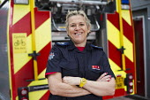 Last role call for Sian Griffiths, White Watch Manager. Retiring after 30 years and one of the first LFB female firefighters. Paddington Fire Station. London. - Jess Hurd - 2010s,2015,adult,adults,cities,city,commander,commanders,employee,employees,Employment,FEMALE,Fire,fire brigade,firefighter,firefighters,fireman,firemen,fires,job,jobs,lbr,MATURE,officer,officers,olde