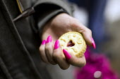 Homeless transvestite with a jammy dodger biscuit provided by the Homeless Outreach project run by the As-Suffa Institute. As-suffa Institute, an Islamic community organisation, part of the Birmingham... - Jess Hurd - &,2010s,2015,BAME,BAMEs,belief,Birmingham,Black,BME,bmes,charitable,charity,cities,city,communities,community,conviction,distributing,distribution,diversity,environment,EQUALITY,ethnic,ethnicity,exclu