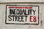 Inequality Street sign- stencil graffiti about the gentrification of the London Borough of Hackney, E8. - Jess Hurd - 07-04-2015