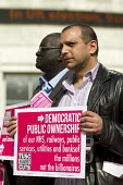 Unjum Mirza, tube train driver, RMT rep. and TUSC ppc. Trade Union and Socialist Coalition, TUSC launch their election manifesto at Canary Wharf. London Docklands. - Jess Hurd - 2010s,2015,BAME,BAMEs,black,BME,bmes,campaign,campaigning,CAMPAIGNS,candidate,candidates,Coalition,cultural,DEMOCRACY,diversity,driver,DRIVERS,DRIVING,ELECTION,elections,ethnic,ethnicity,General Elect