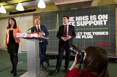 Ed Balls speaking, with Liz Kendall MP and Andy Burnham MP. Launch of NHS week, including new analysis of Conservative plans, a poster launch and Q&A, London. - Jess Hurd - 20-04-2015