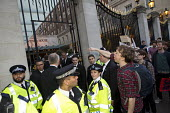 Social housing and anti-gentrification campaigners disrupt the annual Property Awards attended by luxury property development companies. Grovesnor Hotel, Park Lane. London. - Jess Hurd - CLJ,2010s,2015,activist,activists,adult,adults,against,Aylesbury,campaign,campaigner,campaigners,campaigning,CAMPAIGNS,Carpenters,DEMONSTRATING,Demonstration,DEMONSTRATIONS,development,E15,Estate,ESTA