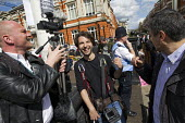 Police Liaison Officer moves closer to listen in on journalists conversation. Protest to Reclaim Brixton. Against gentrification and regeneration that does not benefit the existing community. South Lo... - Jess Hurd - 25-04-2015