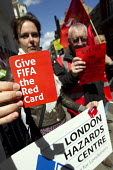 Give FIFA the red card. International Workers Memorial Day outside the Qatar Embassy about the conditions and death toll of workers on Qatar's World Cup construction sites. London. - Jess Hurd - ,2010s,2015,activist,activists,BUILDING,BUILDINGS,CAMPAIGN,campaigner,campaigners,CAMPAIGNING,CAMPAIGNS,construction,Construction Industry,DEMONSTRATING,Demonstration,DEMONSTRATIONS,FEMALE,member,memb
