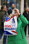 Cool Britannia, tourist photographs the May Day, International Workers Day protest. London. - Jess Hurd - 2010s,2015,activist,activists,adult,adults,age,ageing population,amateur,Amateur Photographer,bag,bags,camera,cameras,CAMPAIGN,campaigner,campaigners,CAMPAIGNING,CAMPAIGNS,Carrier Bag,DEMONSTRATING,De
