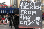 Evict the rich from this city! Class War protest against Poor Doors - different entrances for social housing and penthouse accommodation in Aldgate East. May Day, International Workers Day protest. Lo... - Jess Hurd - 01-05-2015