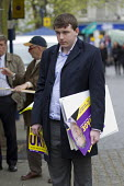 Dejected, UKIP election campaigning for Nigel Farage in Thanet. - Jess Hurd - ,2010s,2015,campaign,campaigning,CAMPAIGNS,CANVASING,canvassing,DEMOCRACY,demoralised,demoralized,despondent,election,elections,eurosceptic,Euroscepticism,eurosceptics,far right,far right,General Elec