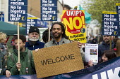 Welcome mat. Election campaigning against UKIP and Nigel Farage in Ramsgate, Thanet. - Jess Hurd - 2010s,2015,activist,activists,against,anti,Anti Racism,anti racist,BAME,BAMEs,Black,BME,bmes,campaign,campaigner,campaigners,campaigning,CAMPAIGNS,DEMOCRACY,DEMONSTRATING,Demonstration,DEMONSTRATIONS,