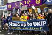 No to UKIP campaigners, against Nigel Farage outside their Ramsgate office. Thanet. - Jess Hurd - 2010s,2015,activist,activists,adolescence,adolescent,adolescents,against,anti,Anti Racism,anti racist,banner,banners,campaign,campaigner,campaigners,campaigning,CAMPAIGNS,DEMOCRACY,DEMONSTRATING,Demon
