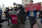 Class War protest against Poor Doors - different entrances for social housing and penthouse accommodation in Aldgate East. The protest marches through London to a squat party in Soho. May Day, Interna... - Jess Hurd - 01-05-2015