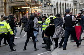 Class War clash with police. Class War protest against Poor Doors - different entrances for social housing and penthouse accommodation in Aldgate East. May Day, International Workers Day protest. Lond... - Jess Hurd - 01-05-2015