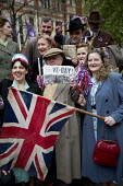 People dress in 1940s vintage period costumes. VE Day (Victory in Europe Day) celebrations marking 70 years since the defeat of Germany in WW2, the end of the second world war in Europe. Whitehall. Lo... - Jess Hurd - WW2,2010s,2015,2nd,ACE,anniversary,apparel,CELEBRATE,CELEBRATING,celebration,celebrations,cities,city,clothes,clothing,costume,costumes,culture,defeat,dress,dressed up,dressing up,Europe,fancy dress,F