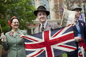 People dress in 1940s vintage period costumes. VE Day (Victory in Europe Day) celebrations marking 70 years since the defeat of Germany in WW2, the end of the second world war in Europe. Whitehall. Lo... - Jess Hurd - WW2,2010s,2015,2nd,ACE,anniversary,apparel,CELEBRATE,CELEBRATING,celebration,celebrations,cities,city,clothes,clothing,communicating,communication,costume,costumes,culture,defeat,dress,dressed up,dres