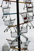 Detail from a sculpture of shopping trolleys called DNA DL90 on a site opposite an Amazon warehouse. The artwork by Abigail Fallis is part of The Line: a new modern art walk. Newham. East London. Comm... - Jess Hurd - 23-05-2015