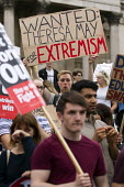 Wanted: Theresa May For Extremism. Anti austerity protests on the day of the Queens Speech and opening of Parliament. Trafalgar Square, London. - Jess Hurd - 27-05-2015