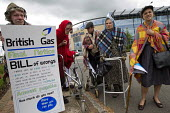 Protest by activists dressed as cold shivering pensioners outside British Gas, Oxford HQ against fuel poverty. Environmental activists delivered to British Gas Headquarters a Bill for funeral costs fo... - Jess Hurd - 01-06-2015