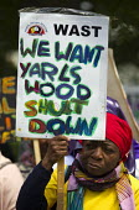 Surround Yarls Wood, End Detention. Set Her Free. Protest outside Yarls Wood Immigration Detention Centre against women in detention. Bedfordshire. - Jess Hurd - 2010s,2015,activist,activists,against,anti,Anti Racism,anti racist,asylum,Asylum Seeker,Asylum Seeker,BAME,BAMEs,bigotry,Black,BME,bmes,CAMPAIGN,campaigner,campaigners,CAMPAIGNING,CAMPAIGNS,center,DEM