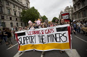 Lesbians and Gays support the miners banner. Peoples Assembly Against Austerity protest against cuts in anti-austerity march. London. - Jess Hurd - 2010s,2015,activist,activists,against,anti,Assembly,Austerity,austerity cuts,banner banners,CAMPAIGN,campaigner,campaigners,CAMPAIGNING,CAMPAIGNS,cuts,DEMONSTRATING,DEMONSTRATION,DEMONSTRATIONS,disput