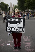Westminster - Paedophile Playground placard. Peoples Assembly Against Austerity protest against cuts in anti-austerity march. London. - Jess Hurd - 20-06-2015