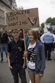 Legalise Tory Hunting placard. Peoples Assembly Against Austerity protest against cuts in anti-austerity march. London. - Jess Hurd - 2010s,2015,activist,activists,adolescence,adolescent,adolescents,against,anti,Assembly,Austerity,Austerity Cuts,boy,boys,CAMPAIGN,campaigner,campaigners,CAMPAIGNING,CAMPAIGNS,child,CHILDHOOD,children,