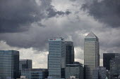 Storm clouds gather over Canary Wharf and the financial buildings in the London Docklands. Poplar, East London. - Jess Hurd - 2010s,2015,America,American,americans,Bank,banking,Banks,Barclays,Barclays Bank,blocks,buildings,CITI,Citibank,cities,Citigroup,City,Citygroup,cityscape,cityscapes,CLOUD,clouds,EBF,Economic,Economy,Fi