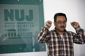 Nablus based Reuters photojournalist Abed Qusini speaks at the NUJ about his work and the safety of journalists. He shows the remote control for his hearing aid after being hit with a concussion grena... - Jess Hurd - 23-06-2015