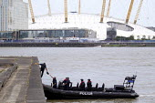 Armed police during an anti terrorism security simulation exercise, Wood Wharf, nr Canary Wharf, London Dockands - Jess Hurd - CTSFO,2010s,2015,adult,adults,and,Anti Terrorist Unit,armed,attack,attacking,attacks,boat,boats,CLJ,Counter Terrorism,Counter Terrorist Specialist Firearms Officer,Crime,exercise,exercises,firearms,fo