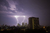 Lightening bolts strike financial buildings, including Barclays, CitiBank and JP Morgan. Canary Wharf. Docklands, East London. - Jess Hurd - 03-07-2015