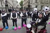 Balls To The Budget, Disabled People Against Cuts throwing balls at Downing Street as George Osborne leaves to deliver his budget to Parliament, Westminster, London - Jess Hurd - (DPAC),2010s,2015,activist,activists,adult,adults,Against,austerity,Austerity Cuts,Balls,CAMPAIGN,campaigner,campaigners,CAMPAIGNING,CAMPAIGNS,civil disobedience,CLJ,Cuts,deliver,DEMONSTRATING,Demonst