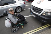 Disabled campaigner blocking the road. Balls To The Budget, Disabled People Against Cuts throwing balls at Downing Street as George Osborne leaves to deliver his budget to Parliament. Westminster. Lon... - Jess Hurd - 08-07-2015