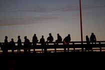 Migrants try to jump onto railway trucks Calais Eurostar Terminal France - Jess Hurd - 2010s,2015,asylum seeker,asylum seeker,BME black,border,border control,border controls,borders,crisis,Diaspora,displaced,ethnic,ETHNICITY,eu,Europe,european,europeans,eurozone,foreign,foreigner,foreig