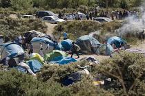 Migrants shelters Calais refugee camp The Jungle France. - Jess Hurd - 2010s,2015,Asylum Seeker,Asylum Seeker,BAME,BAMEs,Black,BME,bmes,border,camp,camping,camps,crisis,Diaspora,displaced,diversity,Ethnic,ethnicity,eu,Europe,european,europeans,eurozone,foreign,foreigner,
