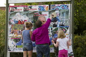 Socialist Party supporters paste over Front National posters. Calais, France. - Jess Hurd - 05-08-2015