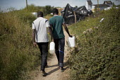 Migrants fetching water Calais refugee camp The Jungle France - Jess Hurd - 02-08-2015