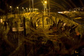 Hundreds of migrants break through outer fences Eurostar Terminal Calais France. - Jess Hurd - 01-08-2015