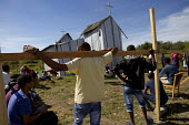 West African migrants Christian service in makeshift church Calais refugee camp The Jungle France. - Jess Hurd - 02-08-2015