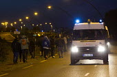 French CRS riot police monitor migrants attempting to break through fences Eurostar Terminal Calais France. - Jess Hurd - 02-08-2015