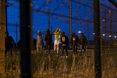 Migrants trying to get to UK break through fences and walk along tracks Calais Eurostar Terminal France - Jess Hurd - 03-08-2015