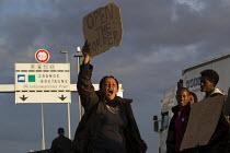 Migrants protest that UK open the border Calais Eurostar Terminal France - Jess Hurd - ,2010s,2015,activist,activists,asylum seeker,asylum seeker,BME black,border,border control,border controls,borders,CAMPAIGN,campaigner,campaigners,CAMPAIGNING,CAMPAIGNS,crisis,DEMONSTRATING,DEMONSTRAT