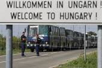 Welcome to Hungary, refugees using the Beremend, Hungarian border crossing. Hungary. - Jess Hurd - 2010s,2015,Asylum Seeker,Asylum Seeker,border,border borders,border control,border controls,borders,bus buses,CLJ,crisis,Croatia Croatian,cross,crosses,crossing,diaspora,displaced,foreign,foreigner,fo