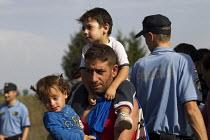 Refugees using the Beremend, Hungarian border crossing. Hungary. - Jess Hurd - 2010s,2015,Afghan,afghans,Asylum Seeker,Asylum Seeker,BAME,BAMEs,BME,bmes,border,border borders,border control,border controls,borders,boy boys,child children,crisis,Croatia Croatian,cross,crosses,cro