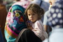 Refugees using the Beremend, Hungarian border crossing. Hungary. - Jess Hurd - UCW,2010s,2015,Afghan,afghans,Asylum Seeker,Asylum Seeker,BAME,BAMEs,BME,bmes,border,border borders,border control,border controls,borders,child children,crisis,Croatia Croatian,cross,crosses,crossing