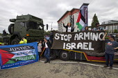 Stop DSEi arms fair protest prevents military vehicle entering ExCel centre London Stop Arming Israel. Defence Security and Equipment International exhibition - Jess Hurd - 07-09-2015