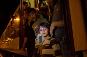 Refugees from the Beremend, Hungarian border crossing are put on trains at Magyarboly, to an unknown location. Hungary. - Jess Hurd - 2010s,2015,adult,adults,Afghan,afghans,Asylum Seeker,Asylum Seeker,BAME,BAMEs,BME,bmes,border,border borders,border control,border controls,borders,boy boys,carriage carriages,child children,crisis,Cr