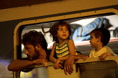 Refugees from the Beremend, Hungarian border crossing are put on trains at Magyarboly, to an unknown location. Hungary. - Jess Hurd - 2010s,2015,adult,adults,Afghan,afghans,Asylum Seeker,Asylum Seeker,BAME,BAMEs,BME,bmes,border,border borders,border control,border controls,borders,carriage carriages,child children,crisis,Croatia Cro