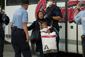 Refugees rush to board a bus to Austria after being pepper sprayed by riot police at Opatovac refugee camp. Croatia. - Jess Hurd - 22-09-2015