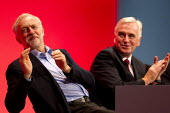 Jeremy Corbyn, leader with John McDonnell MP. Labour Party Conference, Brighton. - Jess Hurd - ,2010s,2015,applauding,applause,conference,conferences,EMOTION,EMOTIONAL,EMOTIONS,Jeremy Corbyn,Labour Party,leader,Party,POL,political,POLITICIAN,POLITICIANS,Politics,smile,SMILES,smiling,WELLBEING