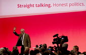 Jeremy Corbyn speaking at Labour Party Conference, Brighton. - Jess Hurd - 2010s,2015,camera,cameras,communicating,communication,conference,conferences,delegate,delegates,Jeremy Corbyn,Labour Party,media,MP,MPs,Party,photographer,photographers,photojournalist,photojournalist